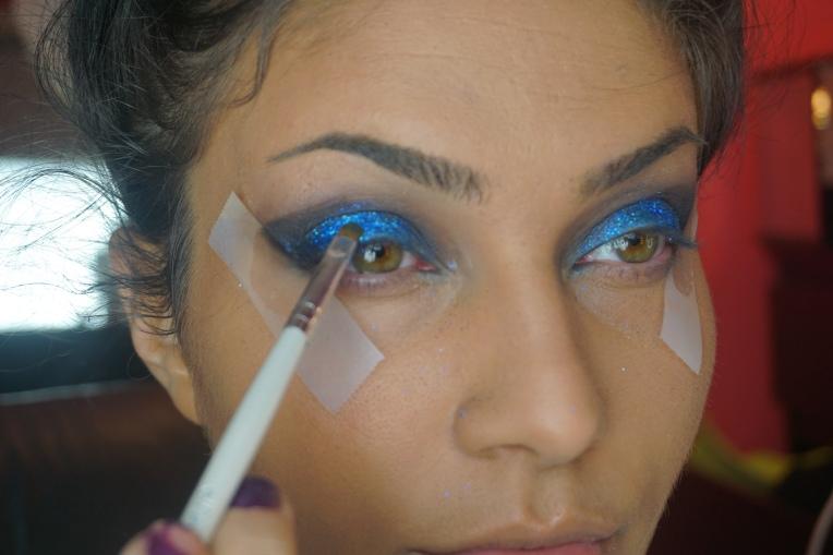 Apply blue glitter