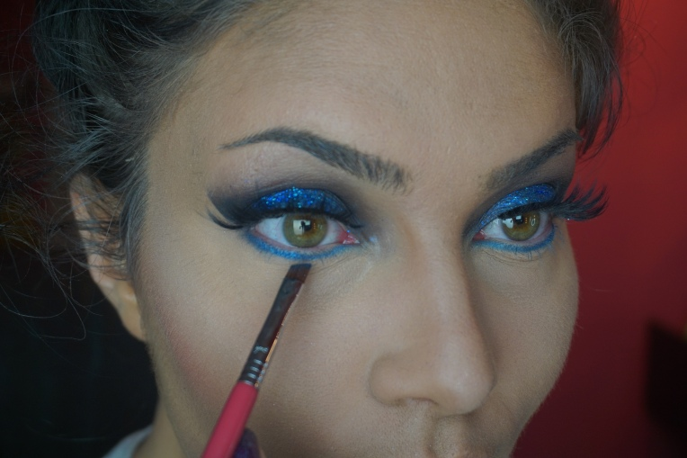 Apply the same matte blue shadow used on the lid, to lower lash line